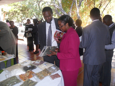 ZCSMBA Executive Secretary with ZDA Director General admiring some of the participants products at the mini exhibition.